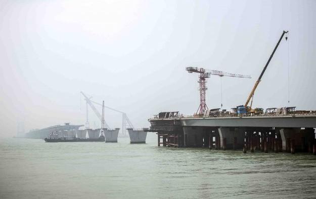 HK govt shifts terms on super bridge 'completion'