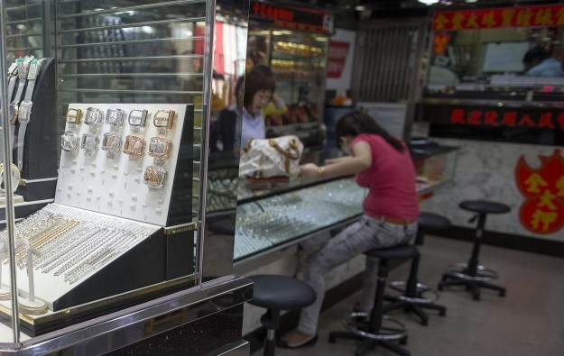 Macau mass GGR may be hit by RMB slide: analysts