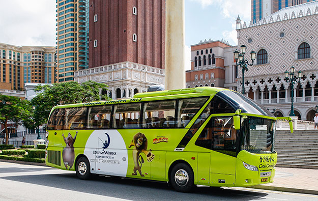 Three Macau casino firms try joint shuttle buses