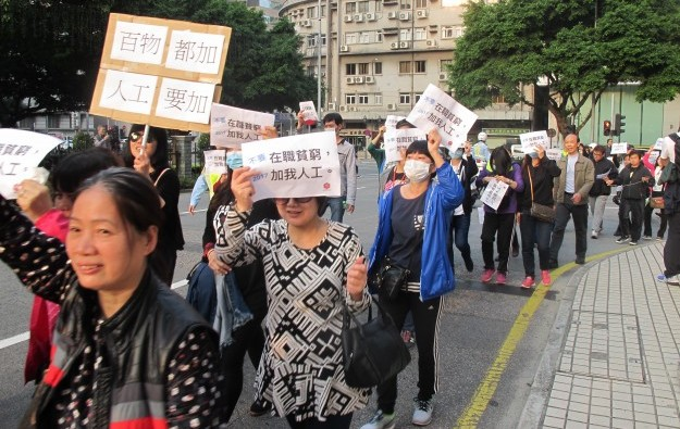Hundreds of Macau casino workers rally for pay hike