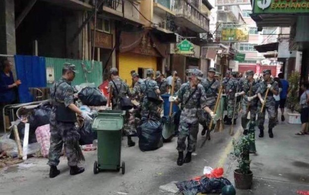 Chinese military joins Macau typhoon clean up