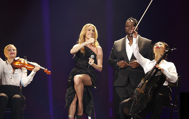 Celine Dion performs in boost for a Caesars casino in Japan