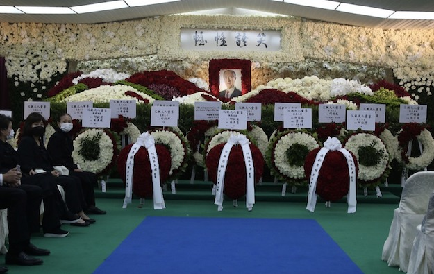 Macau officials at Stanley Ho funeral procession, Jul 10