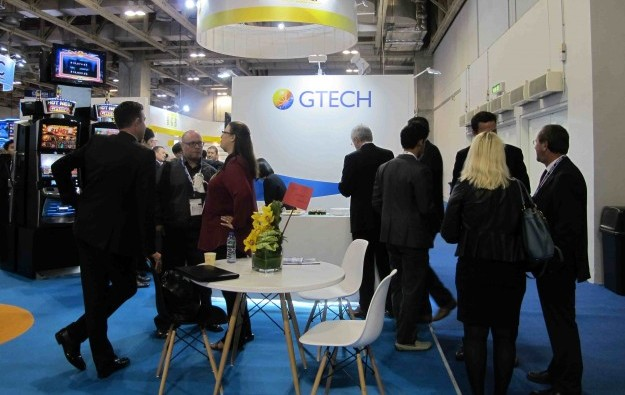 GTech 2014 profit slides 52 pct on IGT acquisition costs