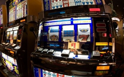 A$9.8 bln spent on pokies in year to March: study
