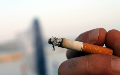 Macau govt warns operator on smoking areas