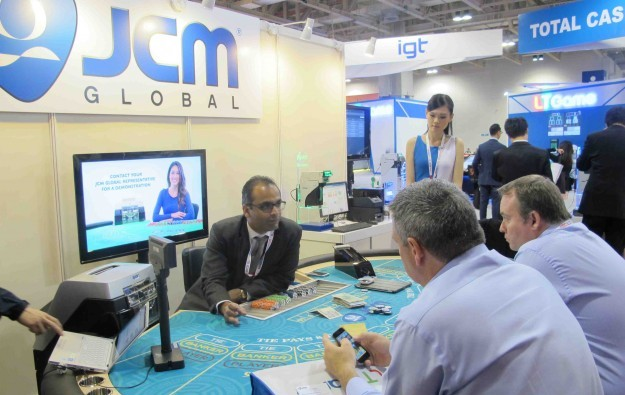 JCM debuts table bill validator at Macao Gaming Show