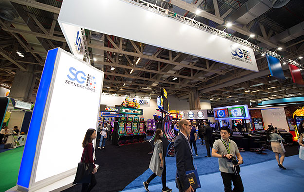 Sci Games slims 3Q loss, heralds new cuts on costs
