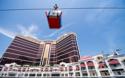 Wynn Macau 4Q profit booms, boss upbeat on fresh rights
