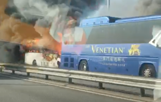 Shuttle-type buses collide, burn on Macau bridge: police